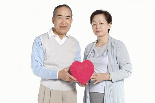 An old couple with a heart gift box 2