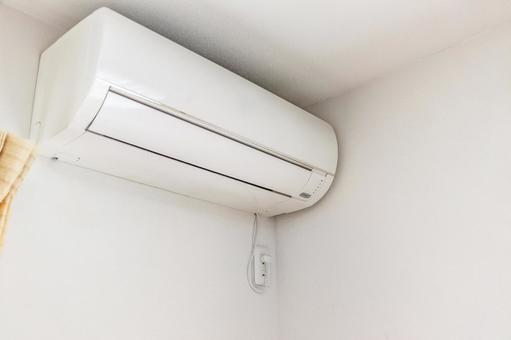 White air conditioner mounted on the wall