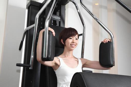 Woman using training machine 12
