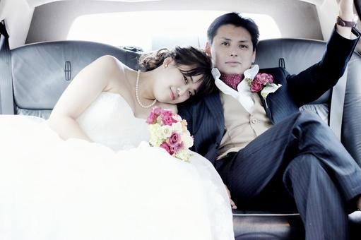Bride and groom heading for wedding ceremony in photo wedding limousine