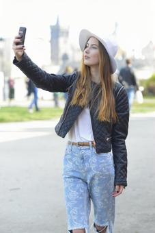 A woman shooting with a smartphone 12