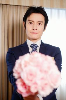 Hotel man with bouquet