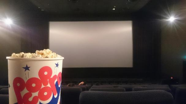 Movie theater screen and popcorn