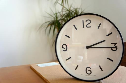 A simple wall clock pointing at 2:15