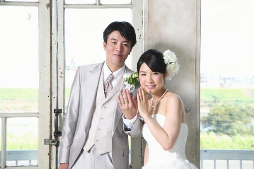 Bride and groom showing wedding rings 2