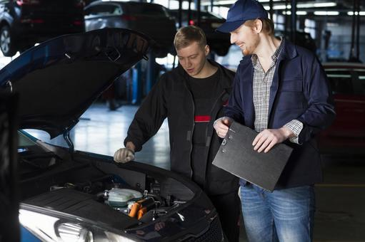 Automobile mechanic checking bonnet 15