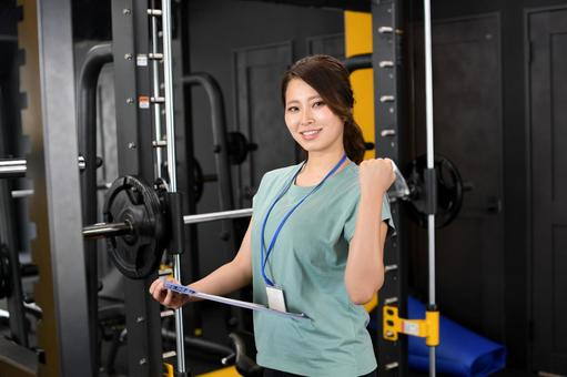 Young woman in gym instructor (trainer)
