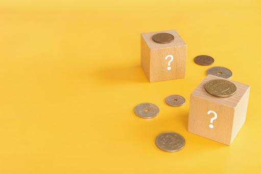 Costs, Expenses | Question Mark Building Blocks and Money