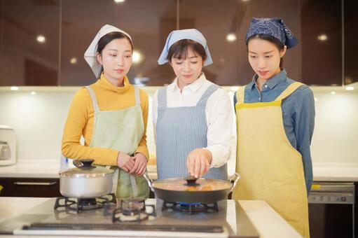 Cooking class Women cooking in a frying pan