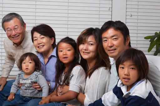 A large Japanese family of 3 generations relaxing in the living room