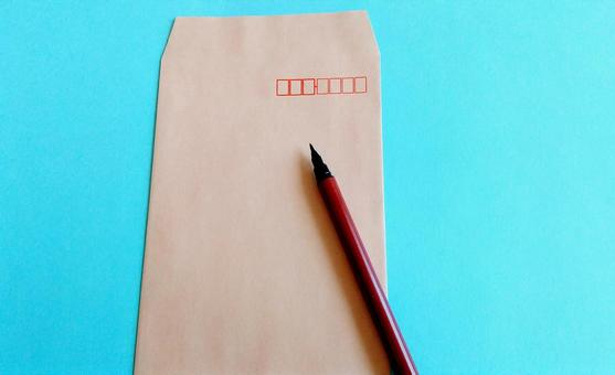 Brown envelope and brush pen