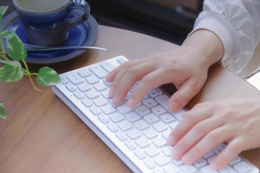 Woman operating a personal computer