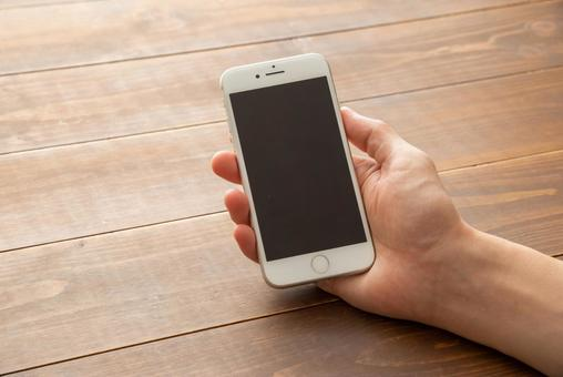 Smartphone right hand wooden table