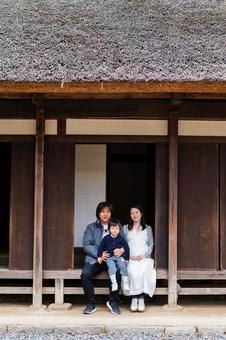 A family of three in an old folk house