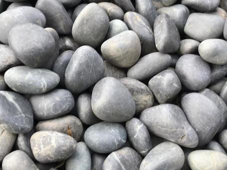 White and round pebbles for decoration of materials, backgrounds and textures