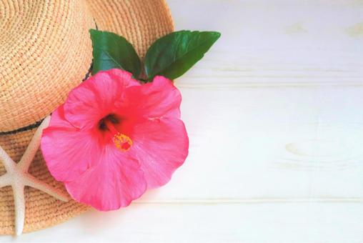 Straw hat and hibiscus