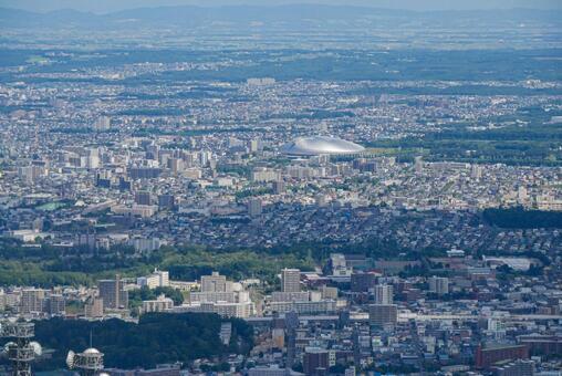 From the observation deck of Mt. Moiwa toward Sapporo Dome in Sapporo City (Sapporo City, Hokkaido)