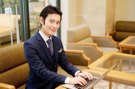 Hotel Man 3 using a laptop