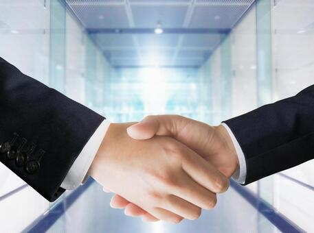 Handshake and office background of a businessman's contract