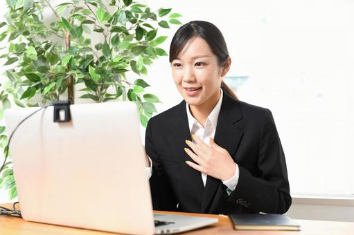 Businesswoman in a laptop and suit