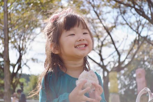 Girl eating rice ball