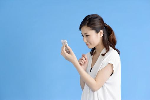 A woman watching a smartphone 1