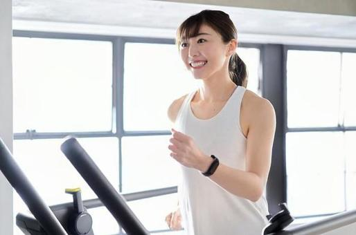 Asian woman running on a treadmill