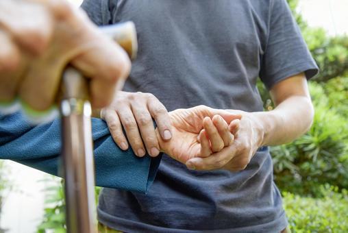 Elderly man with a cane nursing men