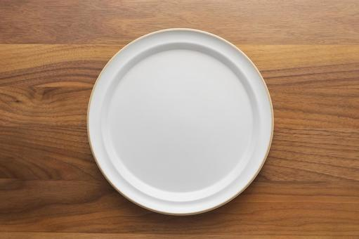 Plate and wooden table