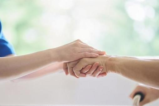 Hands of caregivers and the elderly