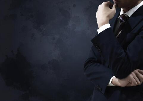 A businessman in a thinking pose