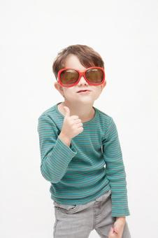 A boy with sunglasses