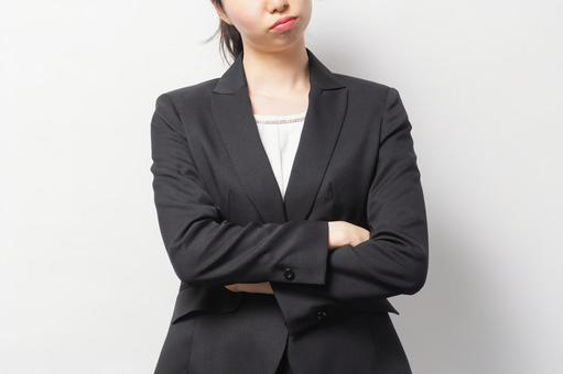 Business woman making a gesture to think in front of a white background