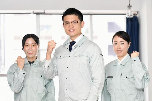 Men and women wearing work clothes that make guts poses