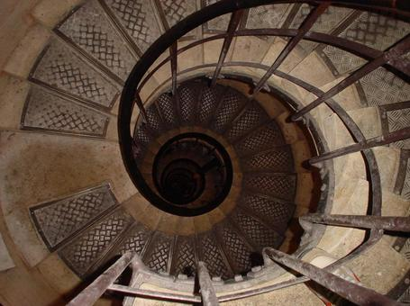 Spiral staircase climbing the Arc de Triomphe