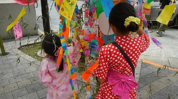 Sisters enjoying the Tanabata Festival