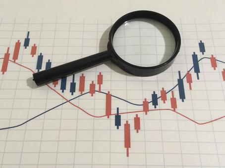 Stock chart and magnifying glass