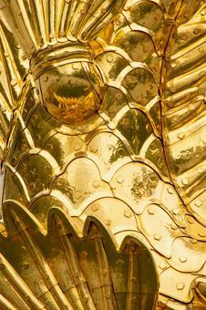 Gold killer whale torso