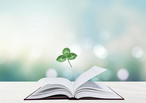 Book and trefoil clover