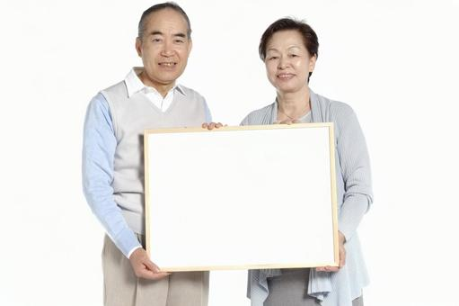 An old couple with whiteboard 1