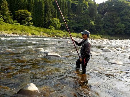 Angler fishing for sweetfish in Nagara River
