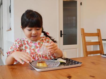 Girl making pudding a la mode