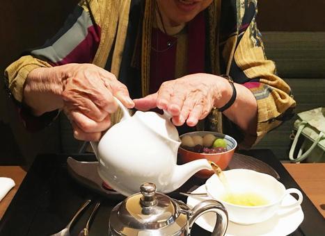 Senior woman enjoying afternoon tea time