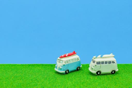Blue sky, meadow and car background material