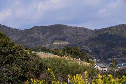 Mikkabi mountain range seen through a mandarin orange field