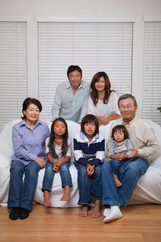 Large Japanese 3rd generation family looking at the camera