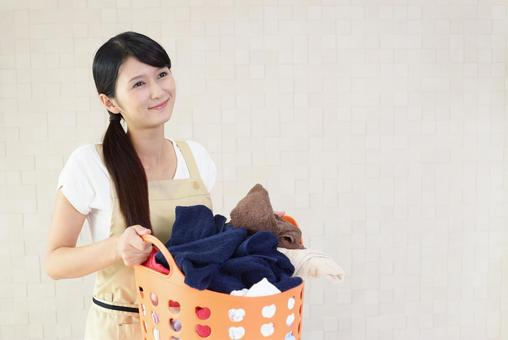 Woman with a laundry basket