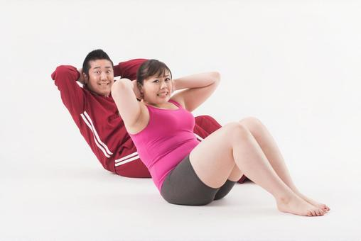 Male and female performing abdominal exercise 5