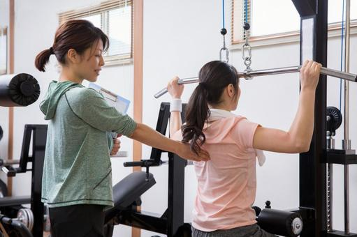 Woman receiving personal training
