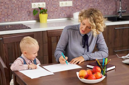 Working mother who holds a son's drawing opponent at the table 7